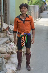 multi-colored construction worker (the foreign photographer - ฝรั่งถ่) Tags: man construction worker orange shirt multicolored sash rubber boots black short khlong lat phrao portraits bangkhen bangkok thailand nikon d3200