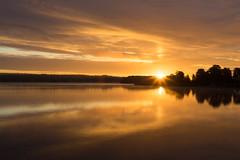 Sunrise over Tange Sø in Denmark (Casper-Larsen) Tags: zeiss loxia 250 sunrise sun lake tange denmark sø water reflection sky