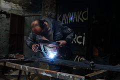 Welder... (K.BERKİN) Tags: worker welder color reflection turkey eye human oldistanbul oldcity people portrait alpha street streetphotograpy streetphoto sony6300 sonyalpha dark handmade job life light istanbul city nature mirroless man iron