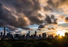sunset from the Met Museum (lucafabbricesena) Tags: newyork manhattan skyline sunset centralpark autumn panoramicterrace sunrays nikon d800 wood tree skyscraper cloudy panorama