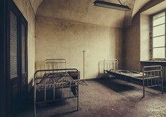 asylum beds (Camera_Shy.) Tags: abandoned asylum medical ospedale exploration urban abandonado italia road trip italy ue mental institute insane derelict decayed disused old beds light shadow urbex vsco nikon d810