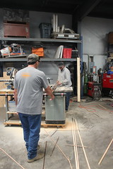 Teamwork on the table saw.