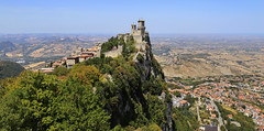 Guaita is one of  the three Towers of San Marino (B℮n) Tags: monumento bartolomeo borghesi universityoftherepublicofsanmarino adriatic sea sanmarino cittàdisanmarino montetitano is land clifftop castlesis enigmatic mysteryis vertiginous views castle slopes mountain republic tourist vacation hills ridge viewpoint clifftops unesco panorama state visiting summer steep trees church palazzopublicco monte titano castellodellaguaita medieval stone wall rooftops cestatower seconda torre 100faves topf100