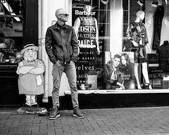 Opposites attract (phil anker) Tags: people street mono salisbury fujix70 juxtaposition