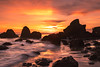 rugged coast (Andy Kennelly) Tags: malibu beach sunset clouds colorful waves rocks pch reflections