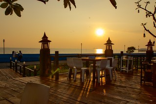 Sunset over the Gulf of Thailand at Rabieng Tale Seafood restaurant in Bang Pu in Samut Phrakan province