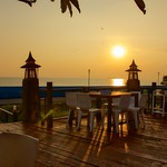 Sunset over the Gulf of Thailand at Rabieng Tale Seafood restaurant in Bang Pu in Samut Phrakan province thumbnail