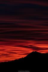 Burning Clouds (Nicola Pezzoli) Tags: colors sunset silhouette clouds sky firesky orange red blue italy bergamo val gandino seriana nature leffe burning fire zoom mountain