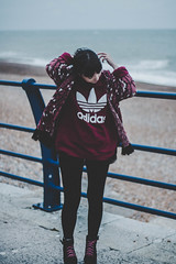 Windswept (ashleyhoughtonmedia) Tags: hastings portrait photography fashion adidas lightroom canon 70d beach sea model lily blue smith f18 east sussex leggings jumper boots pink moody clouds weather exposure england