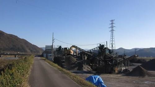 gravel mill running near Hino River mid-day