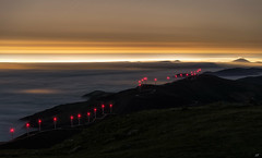 Windy mountains (Ekaitz Arbigano) Tags: ekaitz arbigano landscape night nightscape nocturna larga exposicion long exposure stars fog foggy wind turbine aerogenerador mountain puerto montaña misty mist lights highlights luces paisaje noche views windy