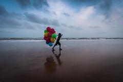 Ballons (Vilvesh) Tags: cwc chennaiweekendclickers cwctravelwalk travelwalk odisha odishamonsoon bhu puri beach reflection sea seashore boy ballons colors nikond750 nikon24120mm tokina1735 bhubaneshwar konark evening clouds sky