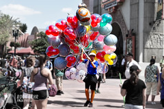 Balloon Seller at Hollywood Studios (rook.behr) Tags: nostalgic hat man balloons plaza crowd castmember street people outdoorscenescape groups bydescription day outdoors disneyworld hollywoodstudios outside scenedesign scenery setdesign setting