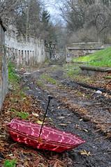 ejected umbrella (rafasmm) Tags: umbrella backyard abramowskiego red city street cell abandoned color łódź lodz poland polska