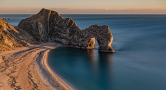 Durdle Door, Dorset (Aleem Yousaf) Tags: durdle door dor natural limestone arch jurrasic coast lulworth dorset england geology concordant coastline rocks shoreline beach unesco world heritage site east devon long exposure neutral density travel nikon 2470mm landscape photography sunset evening sea sky english channel ocean water rock cliff bay mountain