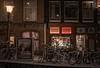 Amsterdam red & white district (reinaroundtheglobe) Tags: amsterdam redlightdistrict noordholland nederland thenetherlands netherlands holland dutch winter snow blizzard bikes shops night lantern buildings