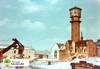 tm_1329 (Tidaholms Museum) Tags: watertower positiv färgat byggnad exteriör fabriksbyggnad 1970 himmelsblå rivning tidaholm vulcan tändsticksfabrik