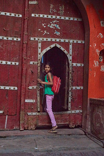 Indian girl at door step, Mathura, India