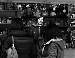 christmas trinkets stall (LozHudson) Tags: manchester christmasmarkets fujifilmx100s fuji x100s street streetphotography blackwhite monochrome people smile