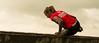 Coming of the fence. (Alex-de-Haas) Tags: 70200mm bootcamprun d5 dutch dutchies geestmerambacht holland langedijk nederland nederlands nikkor nikon noordholland bootcamp candid conquering dirt dirty endurance evenement event fit fitdutchies fitness fun hardlopen joggen jogging mensen modder mud obstacle obstakel overwinnen people plezier recreatie recreation rennen renner renners run runner runners running sport sportief sportiviteit sporty summer team teamspirit teamgeest vies volharding zomer