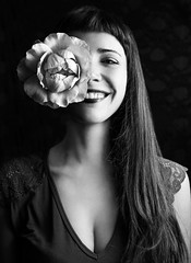 Her first smile (Giulia Valente) Tags: portrait portraiture woman beauty beautiful alone cinematic cinema movie story romance romantic one looking light shadow dark beam darkness mood moody atmosphere dream inspiring blackandwhite blackwhite monochrome mono bw joy smile
