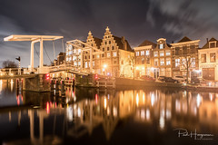 Haarlem cityscape w/ reflection (PaulHoo) Tags: evening night nightphotography nikon d750 wideangle city urban neon light sky clouds longexposure building architecture bridge haarlem holland netherlands 2017 cityscape reflection spaarne
