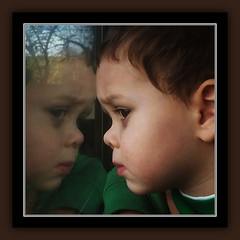 THE BLACK EYE (NC Cigany) Tags: portrait hayden grandson boy train contemplative fearful santa wish blackeye shiner christmas