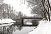 First Snow (arne.lindgren) Tags: stockholm djurgårdsbrunnskanalen snö snow reflections lampposts bridge november winter nikond810 runners trees