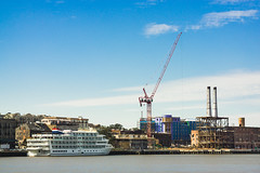 Savannah waterfront. (Gimo Nasiff) Tags: guillermo gino nasiff savannah georgia waterfront ship construction crane river day travel nikon nikonseriese100mmf28 seriese 100mm ga ilce6000 ilcea6000 photography panorama panoramic cityscape historic district chimneys manual lens