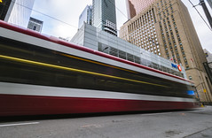Hold on...Just in time....!! (ravi_pardesi) Tags: transportation toronto ttc streets streetsoftoronto streetcar streetphotography streetscape skyline financial district king st public downtown urbanandstreet urbanscape