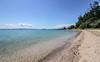 Maraetai Beach (Andy.Gocher) Tags: maraetai wharf andygocher canon100d newzealand beachlands sky clouds water beach bluesky blue green