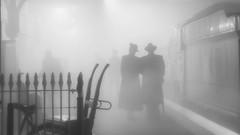 Foggy Night (f22photographie) Tags: timelineevent transport smokemachine lighting reenactors steamswindon people trains nightphotography railways stationplatform hats couple blackandwhite monochrome heritagemuseum steppingbackintime fog foggynight