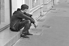Waiting (just.Luc) Tags: man male homme hombre uomo mann young jung jong jeune bn nb zw monochroom monotone monochrome bw france frankrijk frankreich francia frança lyon placebellecour waiting wachtend loitering sitting zittend assis trottoir voetpad footpath sidewalk quote citaat citation