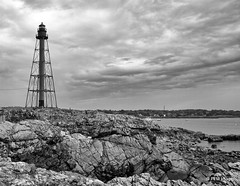 Marblehead Light (pandt) Tags: marbleheadlight light lighthouse marblehead massachusetts skeletal rocks ocean tower clouds sky mono monochrome blackandwhite bw canon eos slr 7d outdoor waterscape landscape sea coast coastal seaside harbor bay