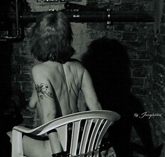 The Plumber's Wife (Jurgistan) Tags: photography nude naked woman female model jurgistan basement black white monochrome noise chair tiedup cuffed handcuffed cuffs handcuffs shadow wall pipes cellar hostage prisoner slave tied dominating dominated grain