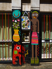 The Strange (Steve Taylor (Photography)) Tags: flower pot gasmeter smileyface dog art graffiti mural streetart window column man uk gb england greatbritain unitedkingdom london smile smiling barred bars