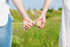 Young Couple Holding Hands Outdoors. (Kseniya Polonskaya) Tags: lovehands couple nature concept hand hands heart love holding summer field background blue man sky harvest human friendship woman sunshine beautiful light people healthy energy happy together sun closeup lifestyle day life girl sunny scene romance wedding green grass tender tenderness care summertime spring valentines happiness family