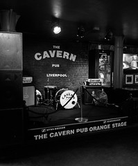 THE CAVERN PUB, Liverpool. (SkipperWP) Tags: pub musicalinstruments drums amplifier bassamplifier blackwhite blackandwhite bw lights indoor stage thecavernpub liverpool cavern uk unitedkingdom monochrome guitar posters guitaramplifier fuji fujifilm travel travelphotography orangestage