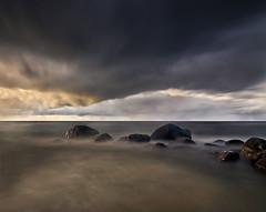 Baltic twilight (Tomas Ruginis) Tags: baltic sea seascape landscape stones autumn clouds longexposure lithuania sky evening sunset stormy