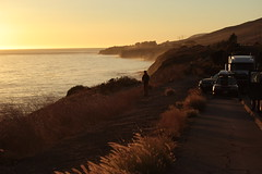 setting solitude (pacfolly) Tags: cars parked oceanparking cliffside sunset hills shrubs person haze view picturesque oceansunset pacificocean