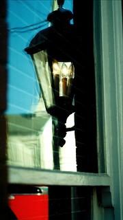 Reflection in old glass, Fredericksburg, Virginia U.S.A.