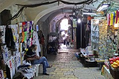 Between Customers (AntyDiluvian) Tags: israel jerusalem oldcity arabmarket shops stores market vendors souk shuk street viadolorosa man guy vendor cellphone keepingbusy