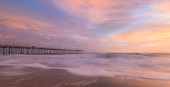 Beautiful light at the Outer Banks Pier (Theresa Rasmussen) Tags: outerbanks sunrise outer banks pier obx nagshead pinkskies waves longexposure yellowskies