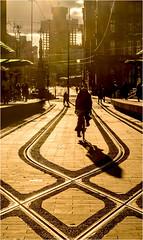 Last Light (Fermat 48) Tags: manchester stpeterssquare sunset silhouette bycicle bike tramstop midlandhotel tramlines shadow buildingworks towerblock canon eos 7dmarkii