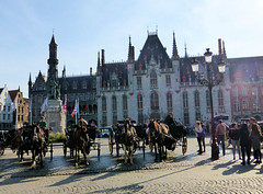 Your carriage awaits ........ Bruges. (Country Girl 76) Tags: bruges belgium horse drawn carriages morning sunlight architecture statue people horses town square city