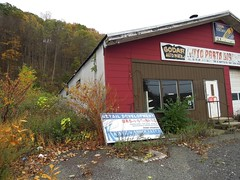 On the way to the DMV to renew my driver's license this morning, I passed this wonderful vestige of the past. An old, abandoned auto parts discount store nestled in the heart of the Palisades mountains. West Haverstraw, New York. Nov 7 2017 (wavz13) Tags: newyorkphotographs newyorkphotography newyorkphotos oldsigns vintagesigns oldbuildings abandonedbuildings vintagebuildings abandonednewyork oldstores abandonedstores hudsonvalley autoparts vintageautoparts abandonedautoparts collectablesigns collectiblesigns rocklandcounty upstatenewyork rainy secretplaces hiddenplaces forgottenplaces vintagestores antiquestores lifeafterpeople tires batteries struts carparts abandoned forgotten weeds regrowth
