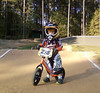 1075 (StriderBikes) Tags: 12 2017 238 boy dirt fly fullface gloves helmet jersey numberplate october orange photocontestentry track trees