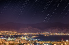 Star trails over Eilat/Aqaba gulf, The Red sea (Alex Savenok) Tags: stars startrails redsea aqaba eilat israel jordan sea cityscape city nightsky nightscape nightfall nikon70300f4556 d610 mountains longexposure