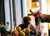Pouring a drink (Maria Eklind) Tags: dof depthoffield kitchentable malmölive restaurant people city abarwithaview drink restaurang pub glass glas skåne malmö skybar street sweden bar skånelän sverige se