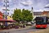 Der rote Bus (Helmut Reichelt) Tags: bus rot spiegelung maibaum schirme stadtplatz streetphoto grafenau bayerischerwald niederbayern bavaria deutschland germany sommer august leica leicam typ240 hdrefexpro2 fhdr leicasummilux35mmf14asphii dxoviewpoint3